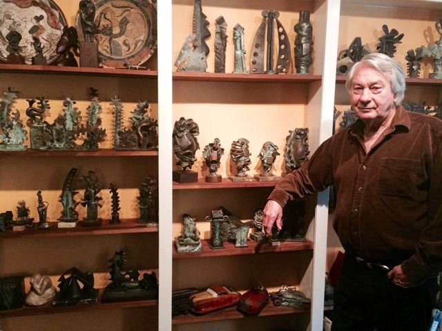 Rubin at home in front of his work mostly.jpg