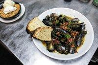 Feature_BestRestaurants_Southbound_Mussels,Collards,Potlikker-BeerBroth,CrispyHam_ChenlaOu_rp1117.jpg