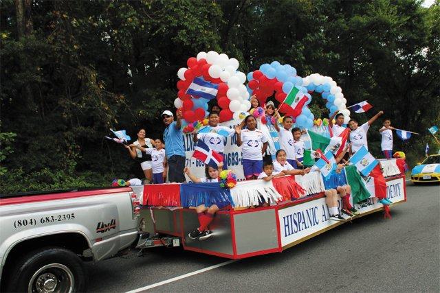 local_news_Hispanic_Parade_float_IMG_2861_COURTESY_JUAN_TEJEDA_rp0918.jpg