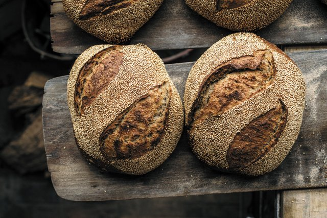 Dining_Column_CommonGrainAlliance_SubRosa_SesameRyeBread_KATE_THOMPSON_COURTESY_SUB_ROSA_BAKERY_rp1018.jpg