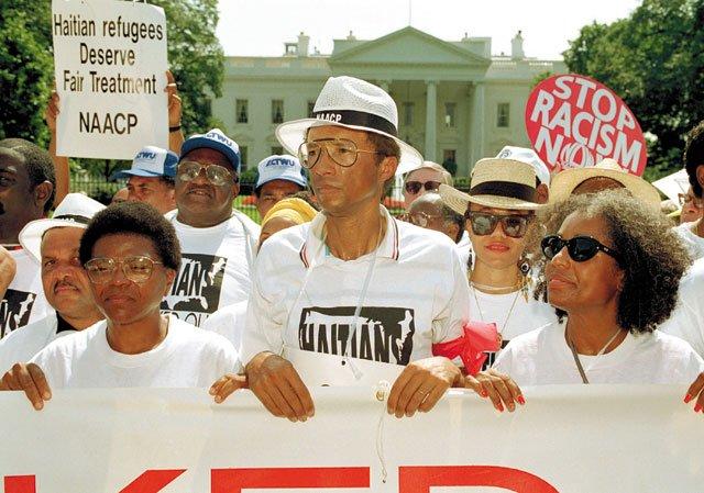 Ashe_Essays_HaitiProtest_GREG_GIBSON_AP_SHUTTERSTOCK_rp1218.jpg