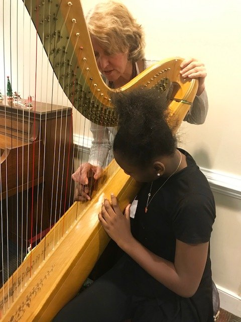 Sunflowers harpist Mary Jane D'Arville