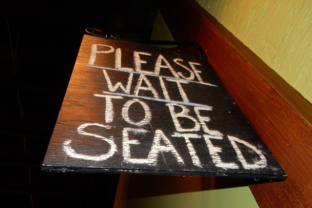 please-wait-to-be-seated-sign_GettyImages-679995138.jpg