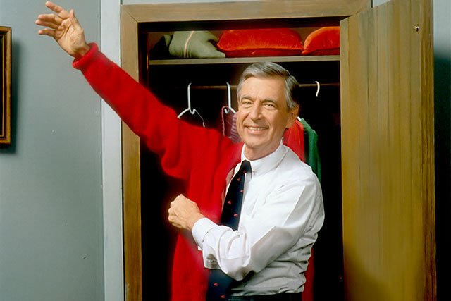 Mister-Rogers-putting-on-sweater_Photo-Credit-The-Fred-Rogers-Company_teaser.jpg