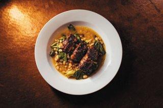 Feature_BestRestaurants_RestaurantAdarra_Stuffed-squid_white-beans_greens_ShawneeCustalow_rp1219_teaser.jpg