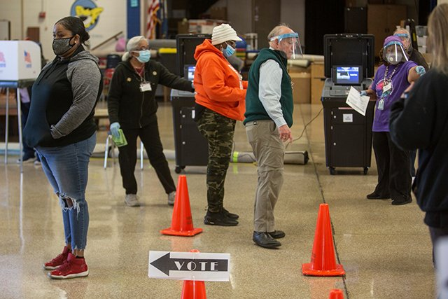 Poll-Workers-at-Charles-M-Johnson-ES_jay-paul_teaser.jpg