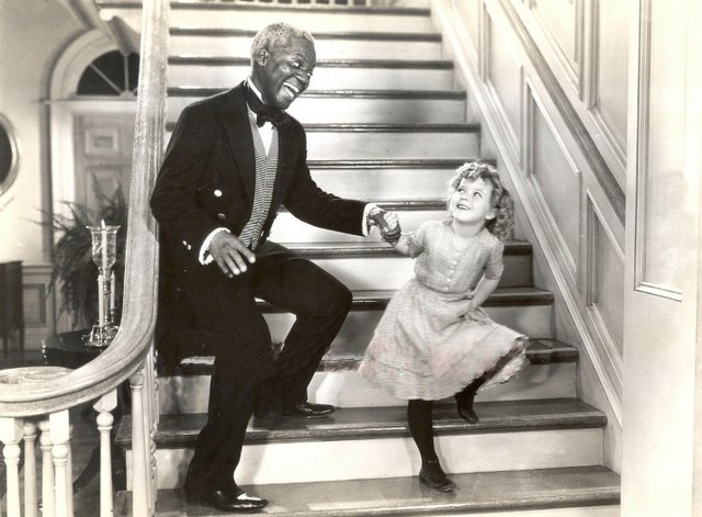 Bill_Robinson_and_Shirley_Temple_stair_dance_(cropped).jpg