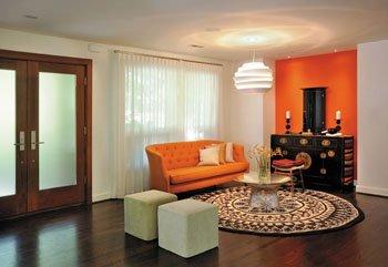 Interior Designer Kristi Lane Transformed The Entry Into A Comfortable  Sit Ting Area. She Created A Vibrant Orange Niche To House Danielsenu0027s  Buddhist Altar ...