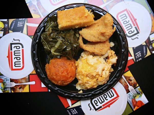 Mama J's catfish nuggets with candied yams, mac 'n' cheese and greens