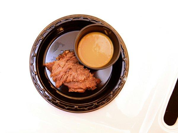 Carena's coconut curry butternut squash soup with crispy Virginia ham, served alongside jerk prime rib