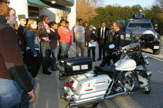 Students view RPD motorcycle, armored vehicle.jpg